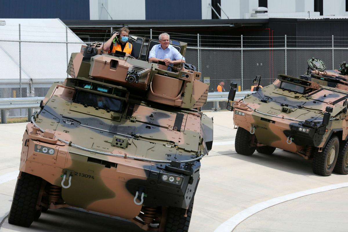 Prime Minister Scott Morrison was given a test drive in the Boxer Combat Reconnaissance Vehicle during the opening ceremony of Rheinmetall Defence Australia's Military Vehicle Centre of Excellence in Queensland. Photo: Corporal Nicci Freeman