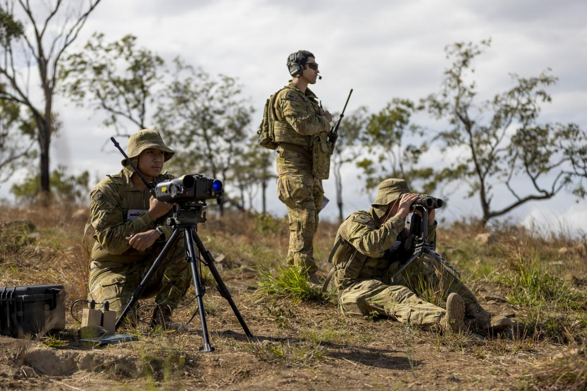 Army Gunner Emmanuel Gomapas, left, and Bombardier Michael Neilson, right,, from the 4th Regiment, Royal Australian Artillery, with Air Force Flight Lieutenant Ebrahim Tabandeh during Exercise Nigrum Pugio. Photo: Captain Lily Charles