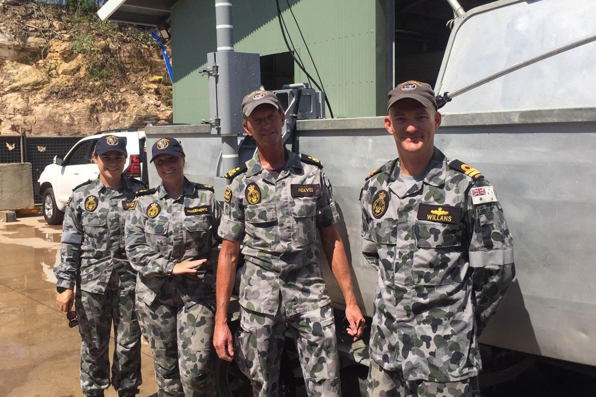 Able Seaman Deneki Stewart, left, Leading Seaman Tanya Maksimovic, Petty Officer David Neaves and Lieutenant Jared Willans with the fly-away survey equipment used to find a submerged watering hole.