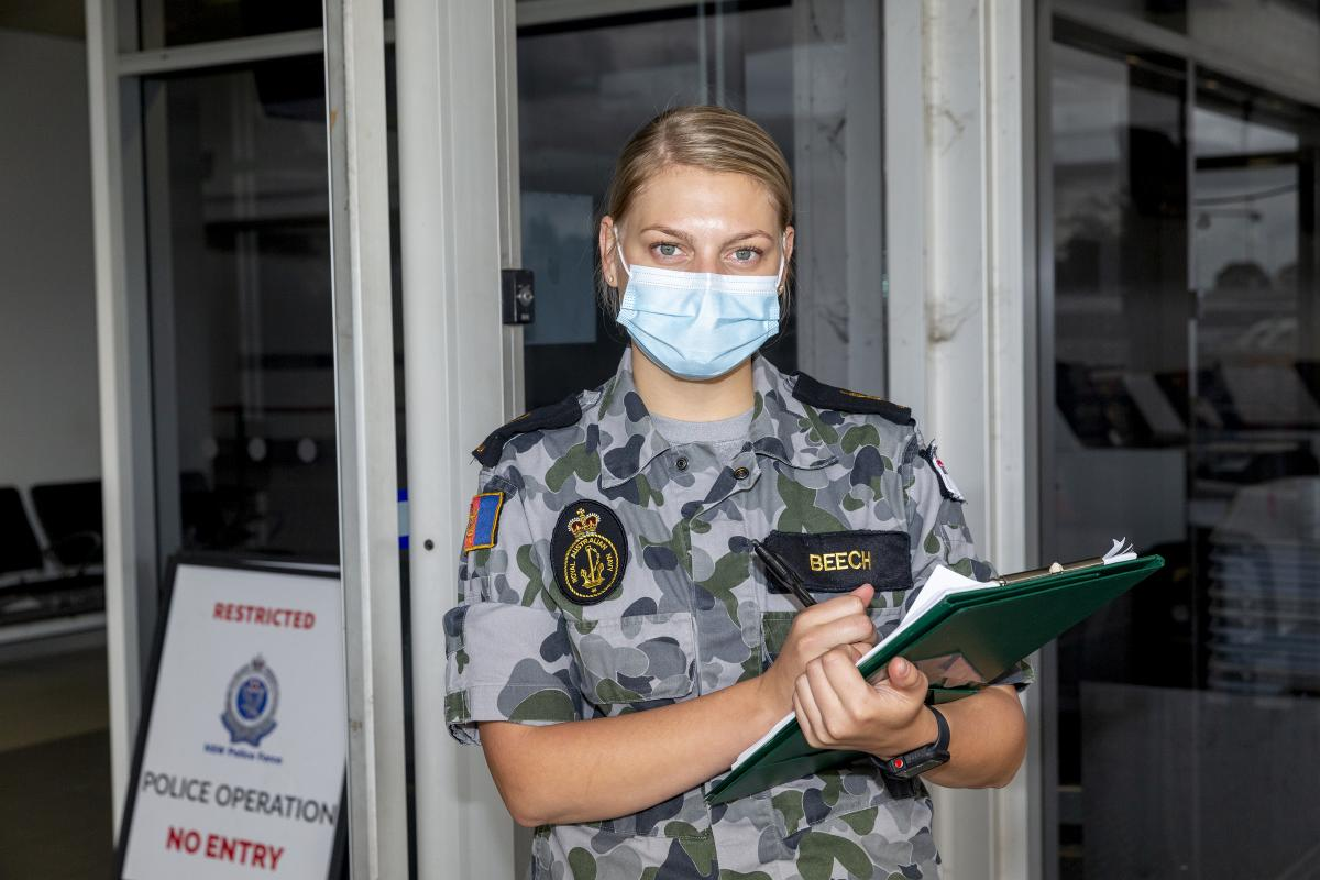Able Seaman Maritime Logistics Support Operations Britney Beech at Sydney Airport during Operation COVID-19 Assist. Photo: Leading Seaman Nadav Harel