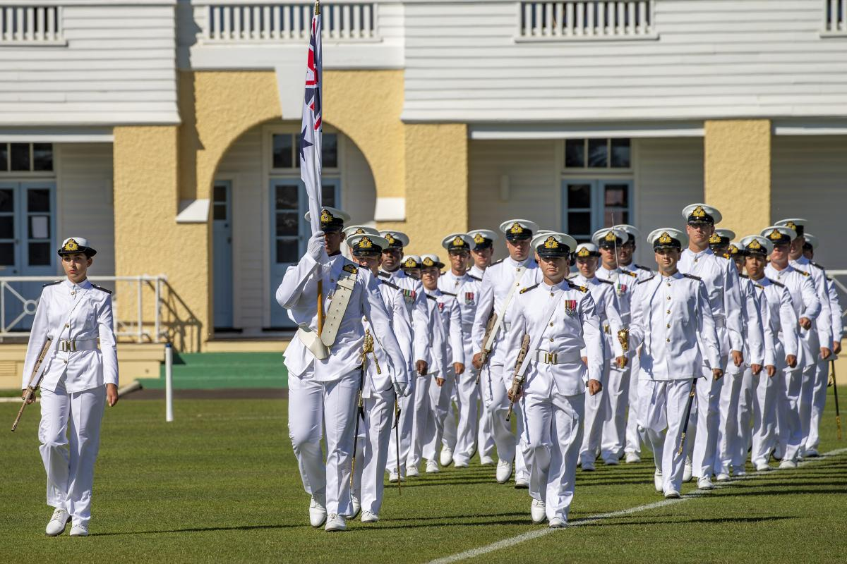 The guard marches onto the parade ground at HMAS Creswell in Jervis Bay during the New Entry Officers Course 63 graduation ceremony. Photo: Chief Petty Officer Cameron Martin