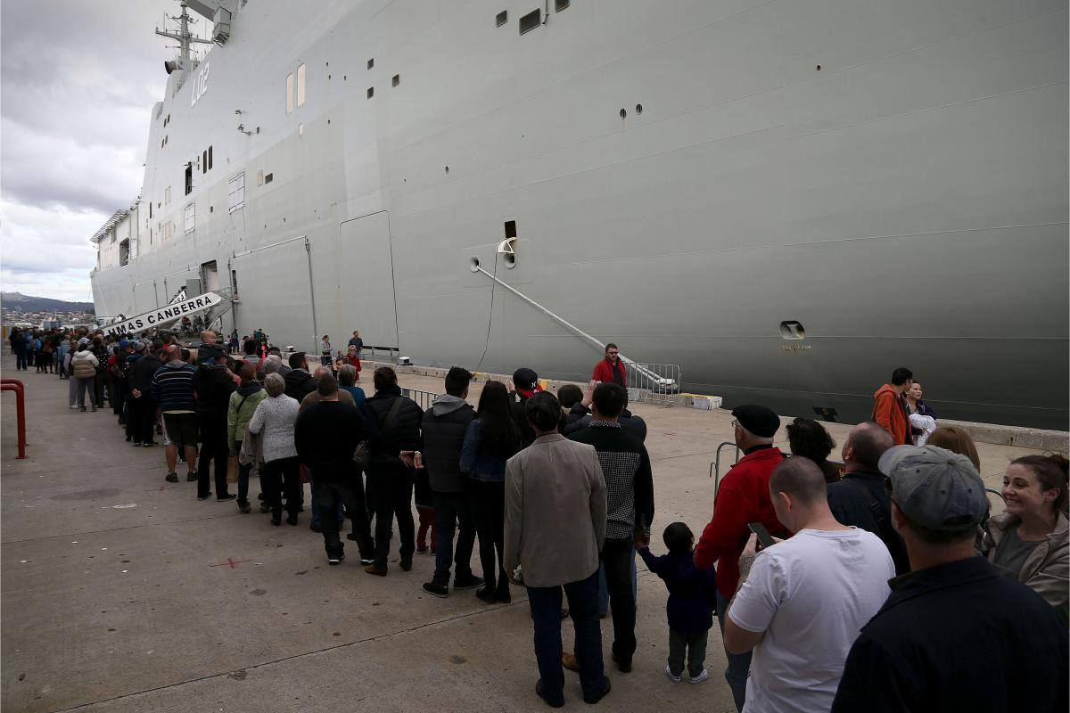 Hobart locals line up to take a tour of HMAS Canberra during her visit in 2015.
