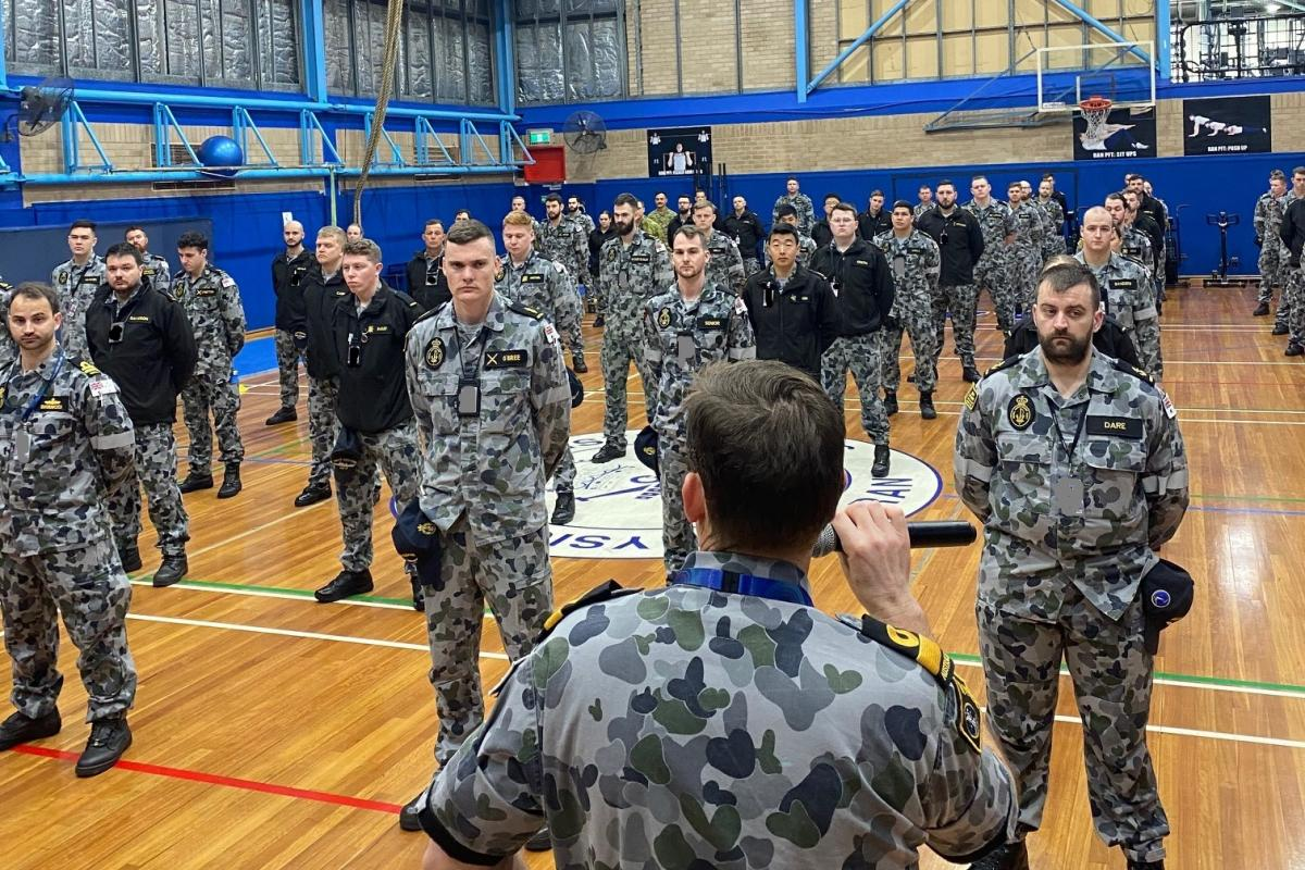 Commander SURFOR Commodore Stephen Hughes briefs personnel before they leave to support Op Covid Assist at Fleet Base East, in Sydney.