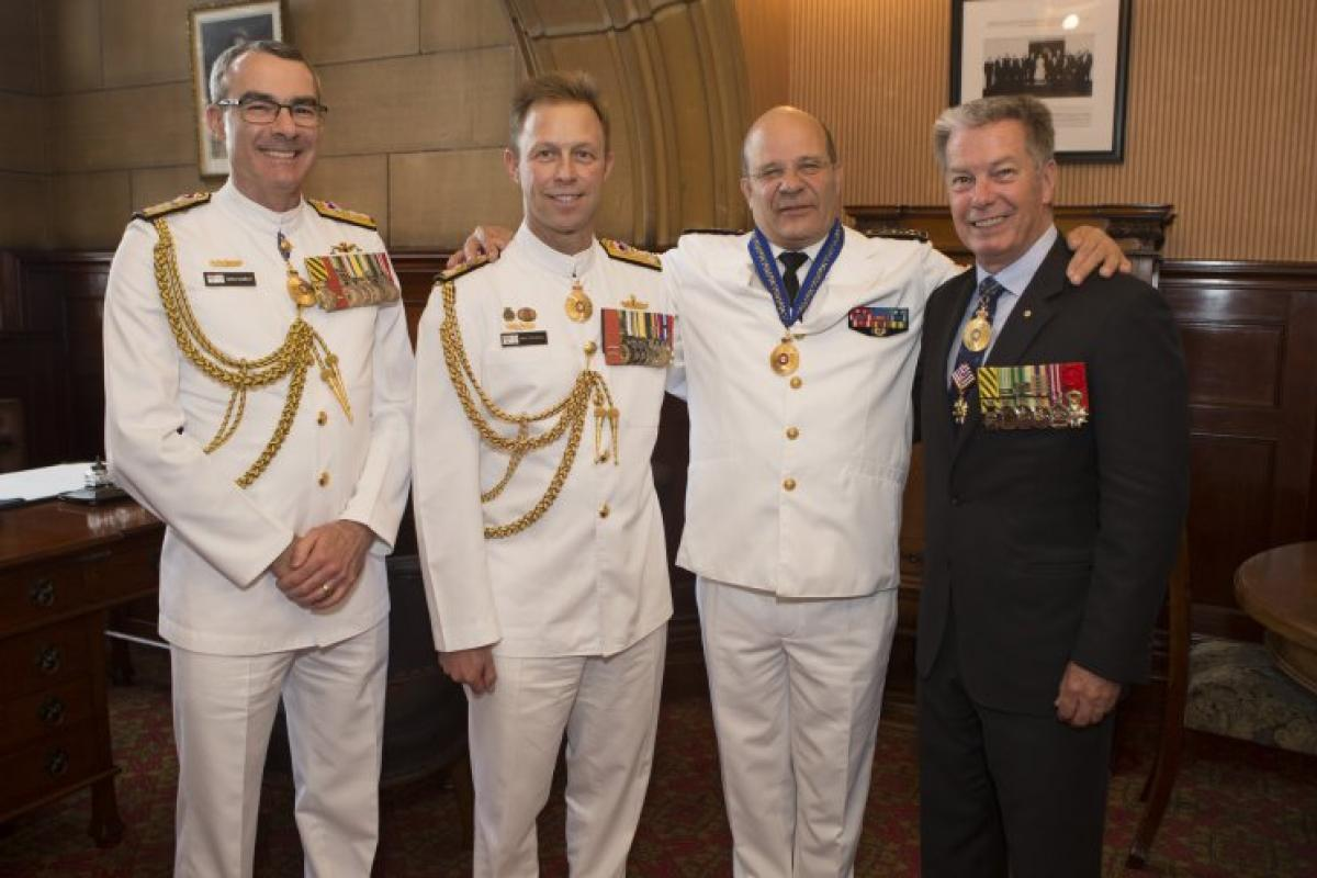 From left, Rear Admiral Greg Sammut AO, Vice Admiral Mike Noonan Christophe Prazuck and Vice Admiral Tim Barrett (retd.) at the investiture ceremony inducting Admiral Prazuck as an Officer of the Order of Australia.