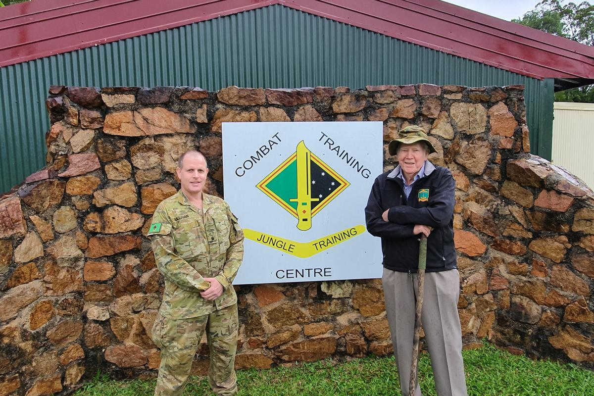 """Major Simon Sullivan and Retired Brigadier """"Warry"""" George Mansford at Jungle Training Wing, Tully."""