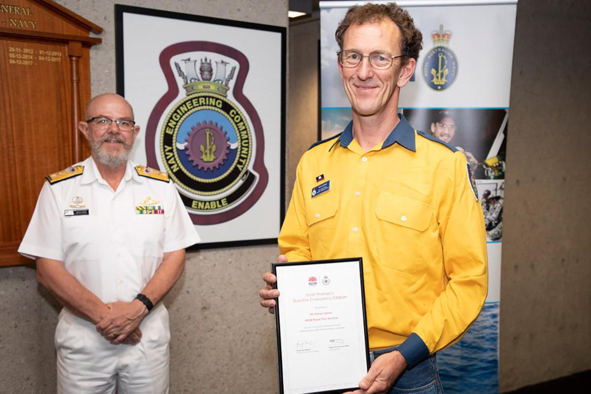 Head of Navy Engineering Branch Commodore Colin Dagg with engineer Simon Sykes who received a NSW Premier's Bushfire Emergency Citation. Photo: Petty Office Bradley Darvill