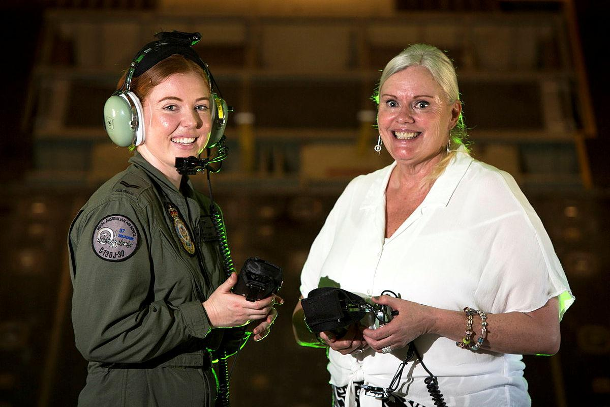 One of the Air Force's newest C-130J Hercules aircraft loadmasters, Corporal Jordyn Luck, is joined by the first-ever female loadmaster, Mrs Katrina Salvesen on board a 130J Hercules at RAAF Base Richmond. Photo: Corporal David Said