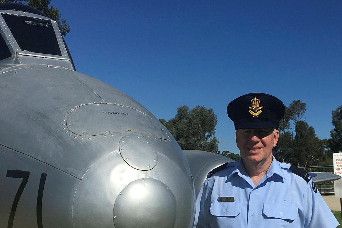 Flying Officer Owen Zupp in front of a Gloster Meteor aircraft at RAAF Base Wagga.