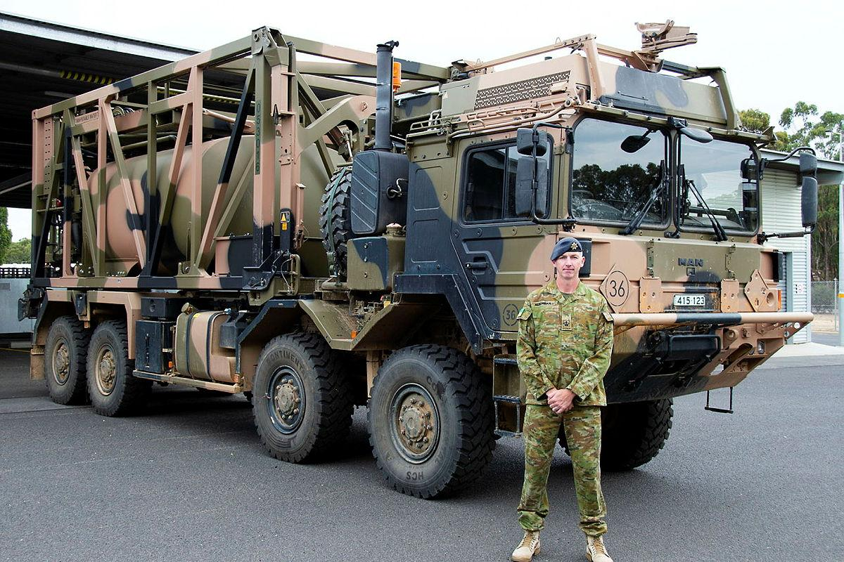 Warrant Officer Class 2 Lance Keighran in front of a MAN HX77 truck at the Army School of Transport in Puckapunyal, Victoria. Photo: Corporal William Spence
