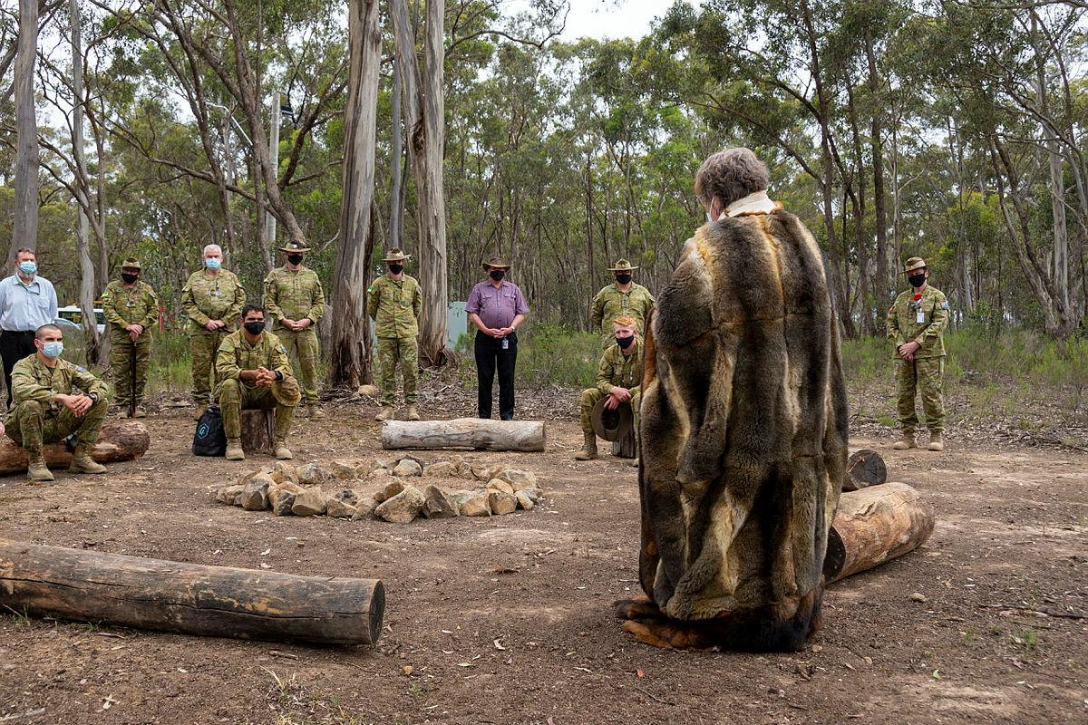 Indigenous Elder Aunty Joanne of the Taungurung Land and Waters Council opens the yarning circle at Puckapunyal.