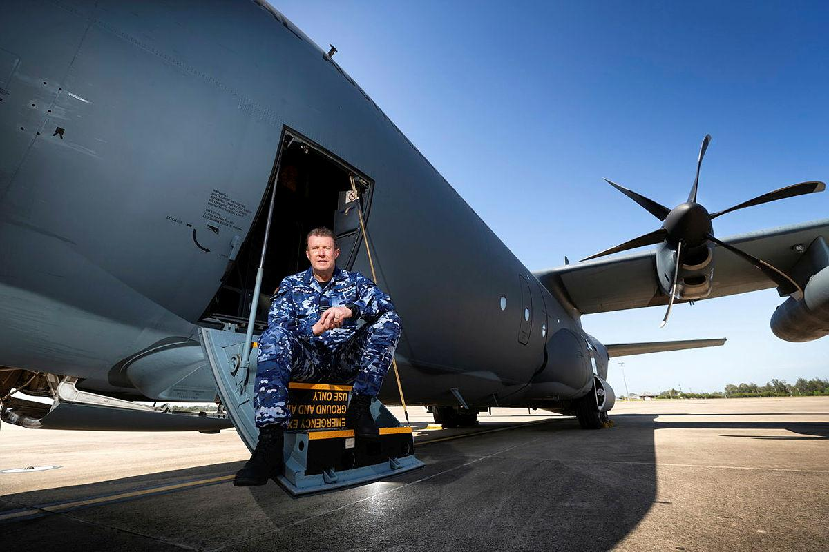 Specialist Reserve Public Affairs Officer Wing Commander Peter Overton on the steps of a No. 37 Squadron C-130J Hercules. Photo: Corporal David Said