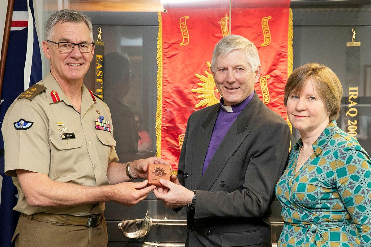 Chief of Army Lieutenant General Rick Burr presents a Federation Star to Bishop Grant Dibden alongside his wife Janet at Russell Offices, Canberra. Photo: Petty Officer Lee-Anne Cooper