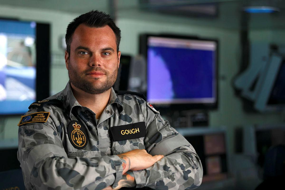 Former apprentice carpenter Leading Seaman Leigh Gough deployed in HMAS Adelaide on Operation Fiji Assist 20-21. Photo: Dustin Anderson