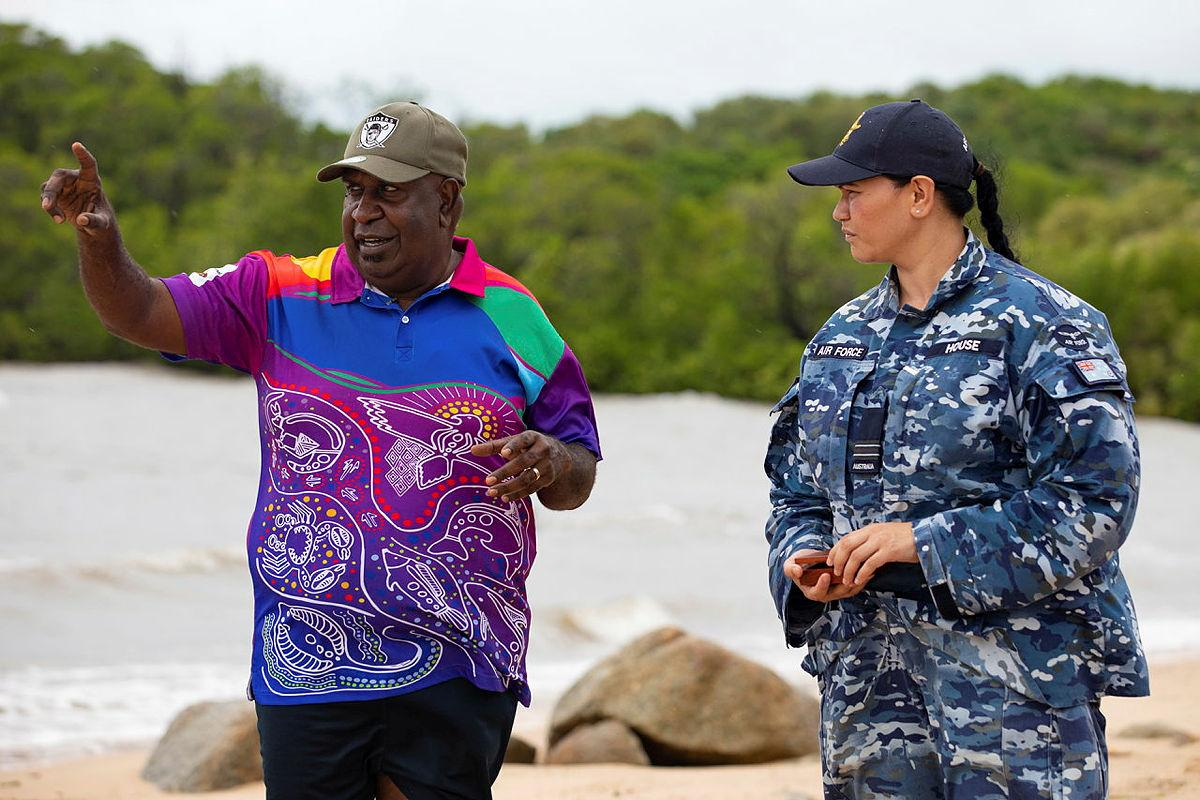 Indigenous Liaison Officer Flight Lieutenant Kristal House engages with Deputy Chair of the Kauareg Native Title Elizah Wasaga on the King's Point beach at Ngurupai (Horn Island) in the Torres Strait. Photo: Corporal Jesse Kane