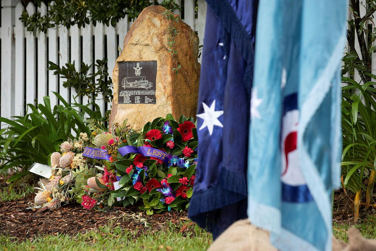 Wreaths surround the memorial plaque at the rededication service commemorating the 80th anniversary of the RAAF Anson A4-5 crash at Glenbrook, NSW. Photo: Corporal Kylie Gibson