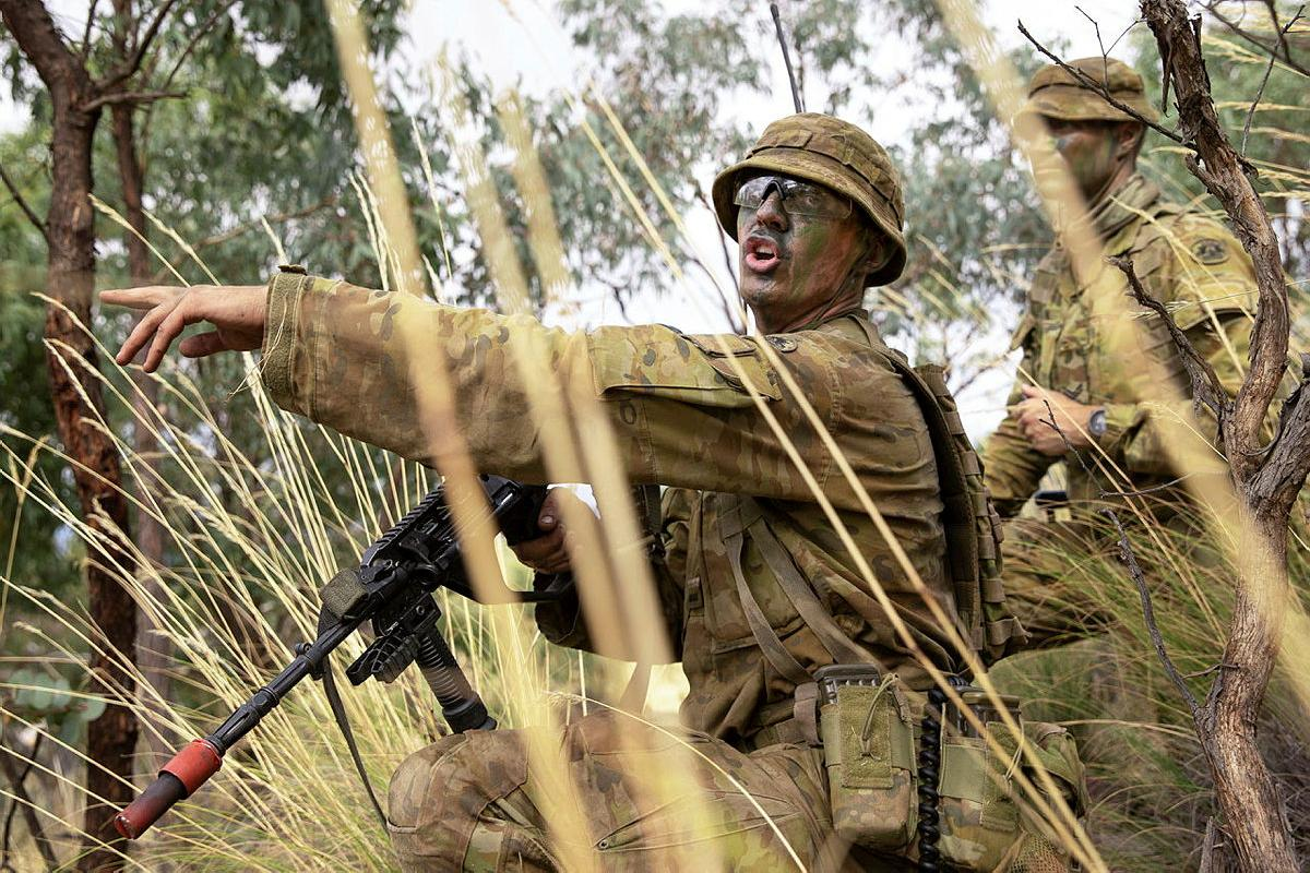 Army Officer Cadet Lachlan Goodall gives orders during a section attack at the Majura Training Area. Photo: Corporal Robert Whitmore