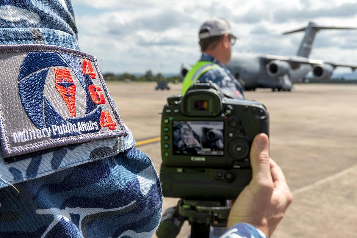 Air Force imagery specialist from the reformed No. 464 Squadron takes imagery at RAAF Base Richmond. Photo: Corporal Dan Pinhorn