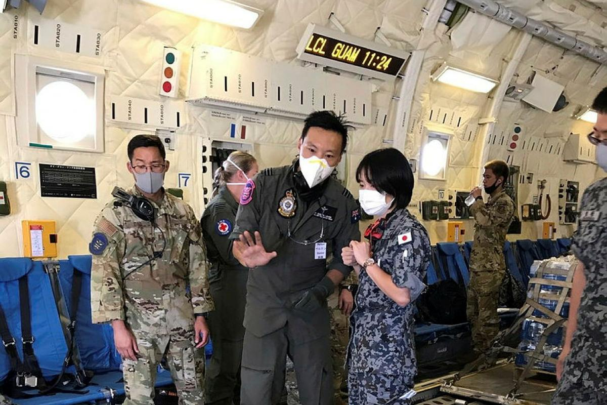 Medical Officer Flight Lieutenant Doctor Perlon Leung, centre, with Japan Air Self-Defense Force and United States Air Force colleagues in a JASDF C-2 during Exercise Cope North. Photo: Squadron Leader Emma Flack