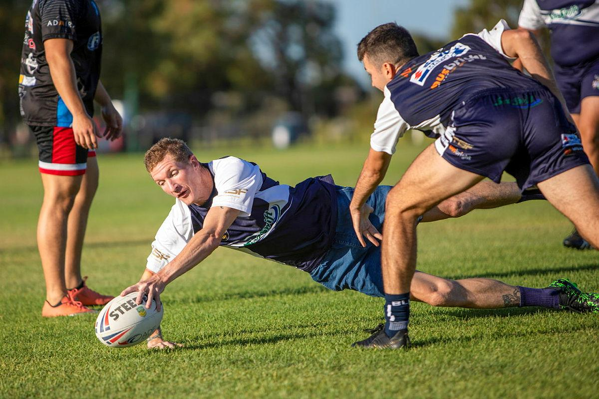 Petty Officer Stephen Swanson participates in a training session with the Navy Tridents rugby league team at the Lark Hill Sporting Complex in Port Kennedy, WA. Photo: Leading Seaman Ernesto Sanchez