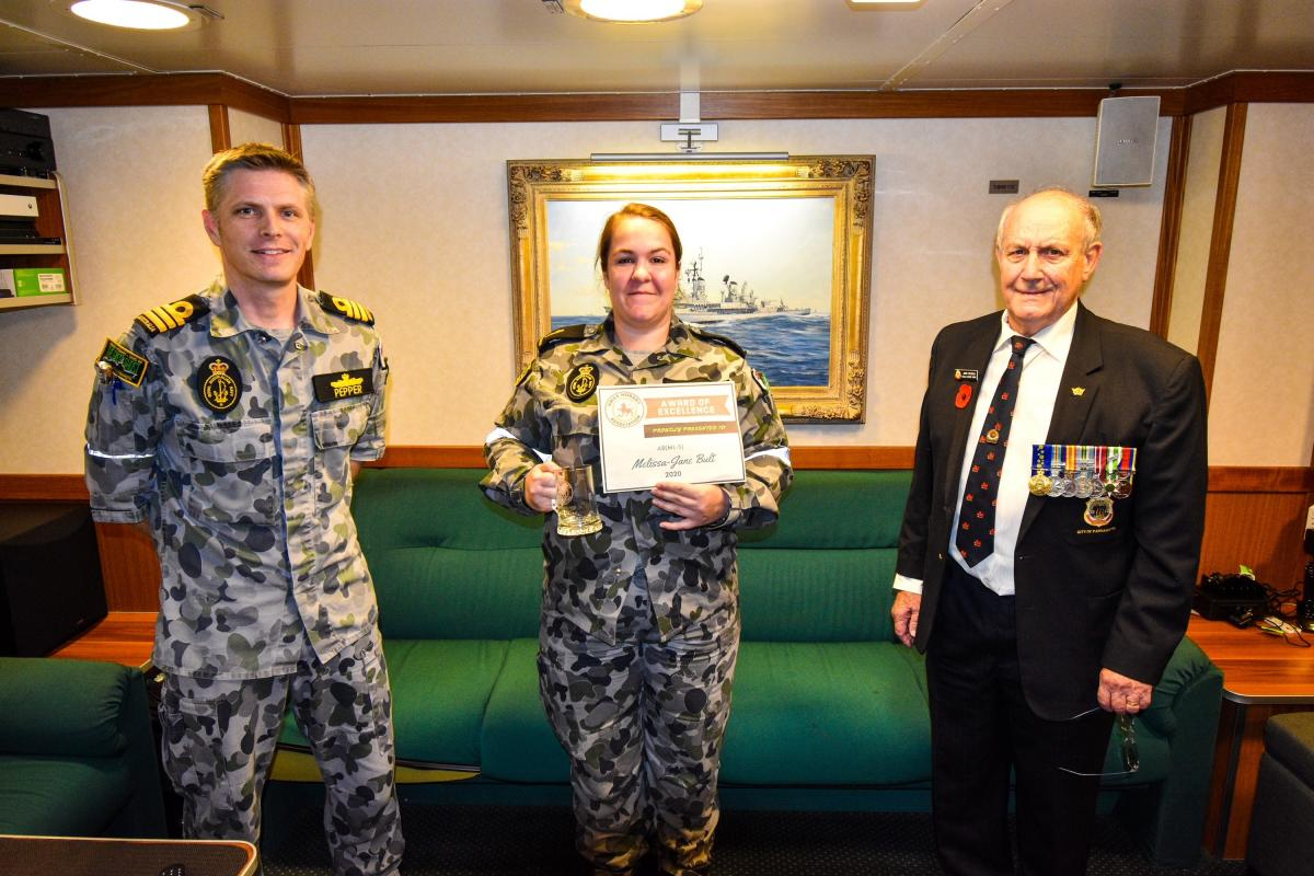 Commander Andrew Pepper with Able Seaman Melissa-Jane Bult and John Withers on board HMAS Hobart. Photo: Petty Officer Brendan Matchett