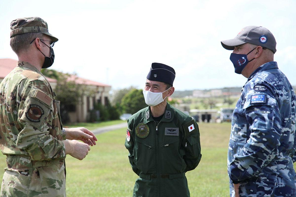 Lieutenant Colonel Adam Shockley from the US Air Force, Colonel Shinobu Yamamoto from the Japanese Air Self-Defense Force and Wing Commander Alan Brown from RAAF discuss operational matters during Exercise Cope North. Photo: Master Sergeant Masumi Suehara
