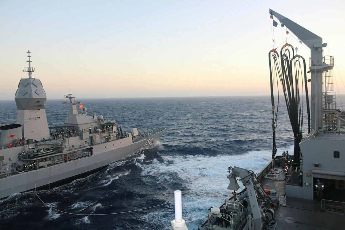 Navy frigate HMAS Anzac in company with HMAS Sirius during a replenishment at sea exercise off the coast of Western Australia.