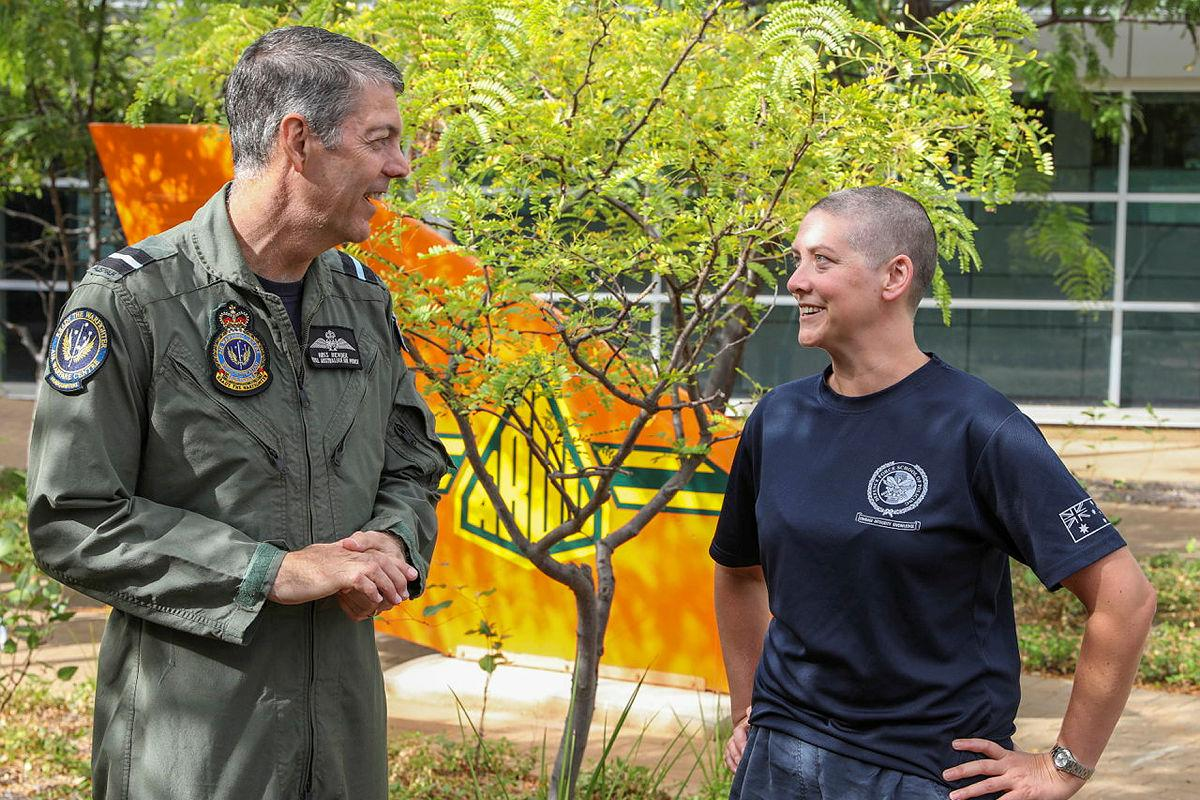 Senior Australian Defence Force Officer - Edinburgh precinct Air Commodore Ross Bender with Flight Lieutenant Lauren Hartley after she had her head shaved to raise money for the Lung Foundation Australia. Photo: Corporal Brenton Kwaterski