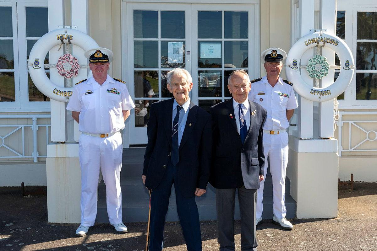 Commander Martin Holzberger, left, and Warrant Officer Tim Brading, right, with former Able Seaman Ronald Bergman and his brother, retired Army Captain Don Bergman. Photo: Leading Seaman James McDougall