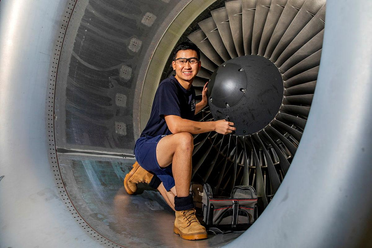 Leading Aircraftman Trung Phan, an aircraft structural fitter from No 36 Squadron, performs maintenance on a C-17 Globemaster III engine at RAAF Base Amberley. Photo: Leading Aircraftwoman Emma Schwenke