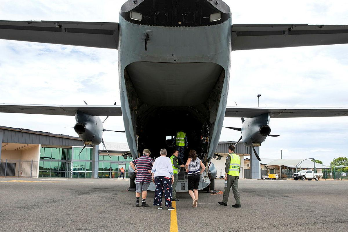 Flight Lieutenant Matthew Still, right, and Loadmaster Corporal Joanna Fletcher give residents a tour of a C-27J Spartan at Charleville Airport, Queensland. Photo: Leading Aircraftwoman Emma Schwenke