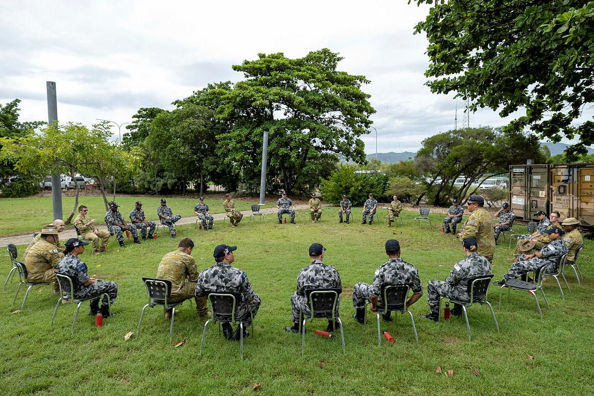 Navy Indigenous Development Program recruits take part in a yarning circle with soldiers from the 10th Force Support Battalion during a visit to Ross Island Barracks in Queensland. Photo: Corporal Brodie Cross