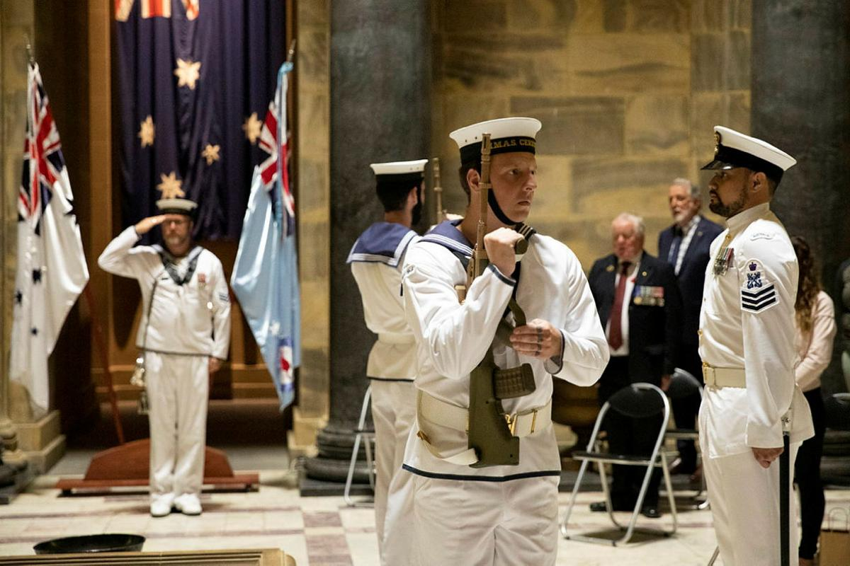 The catafalque party from HMAS Cerberus salutes during a service to commemorate the 79th anniversary of the Battle of Sunda Strait at the Shrine of Remembrance in Melbourne. Photo: Leading Seaman Bonny Gassner