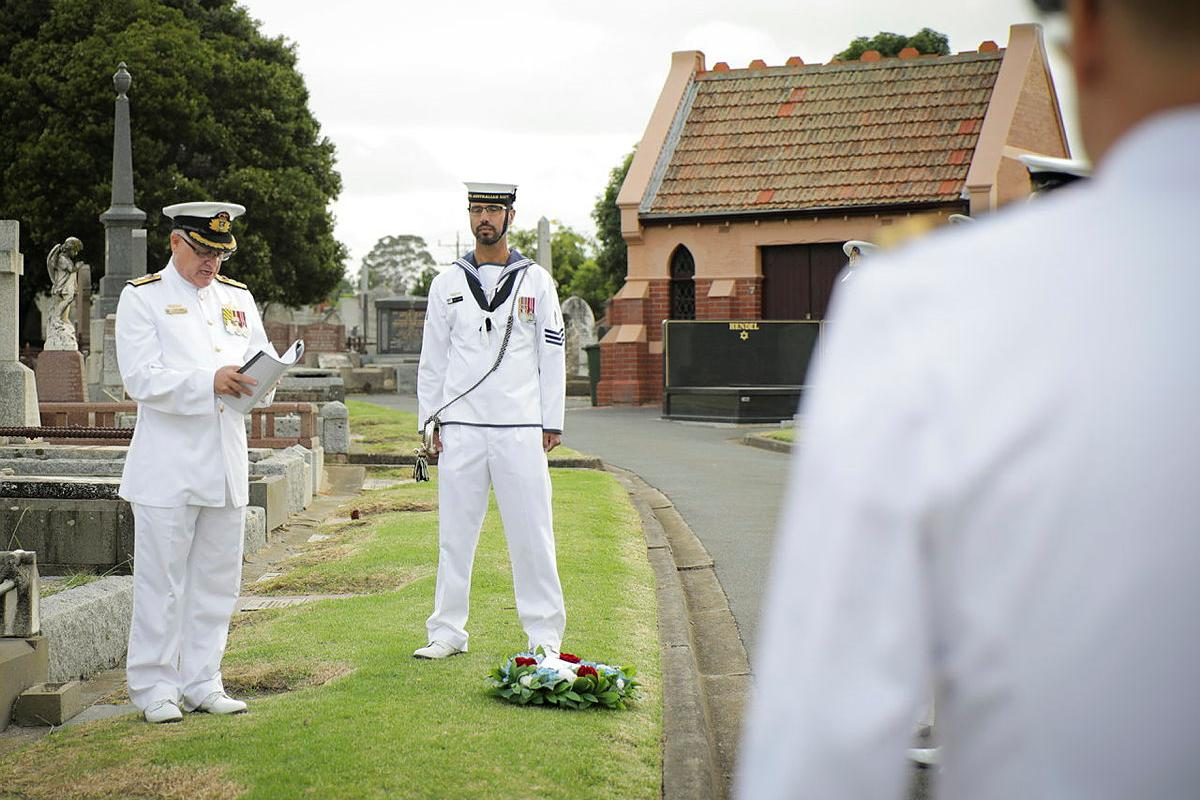 Senior Naval Officer Victoria Commodore Greg Yorke gives a reading during a commemoration service to remember Vice Admiral Sir Rooke Creswell at Brighton Cemetery in Victoria. Photo: Leading Seaman Bonny Gassner