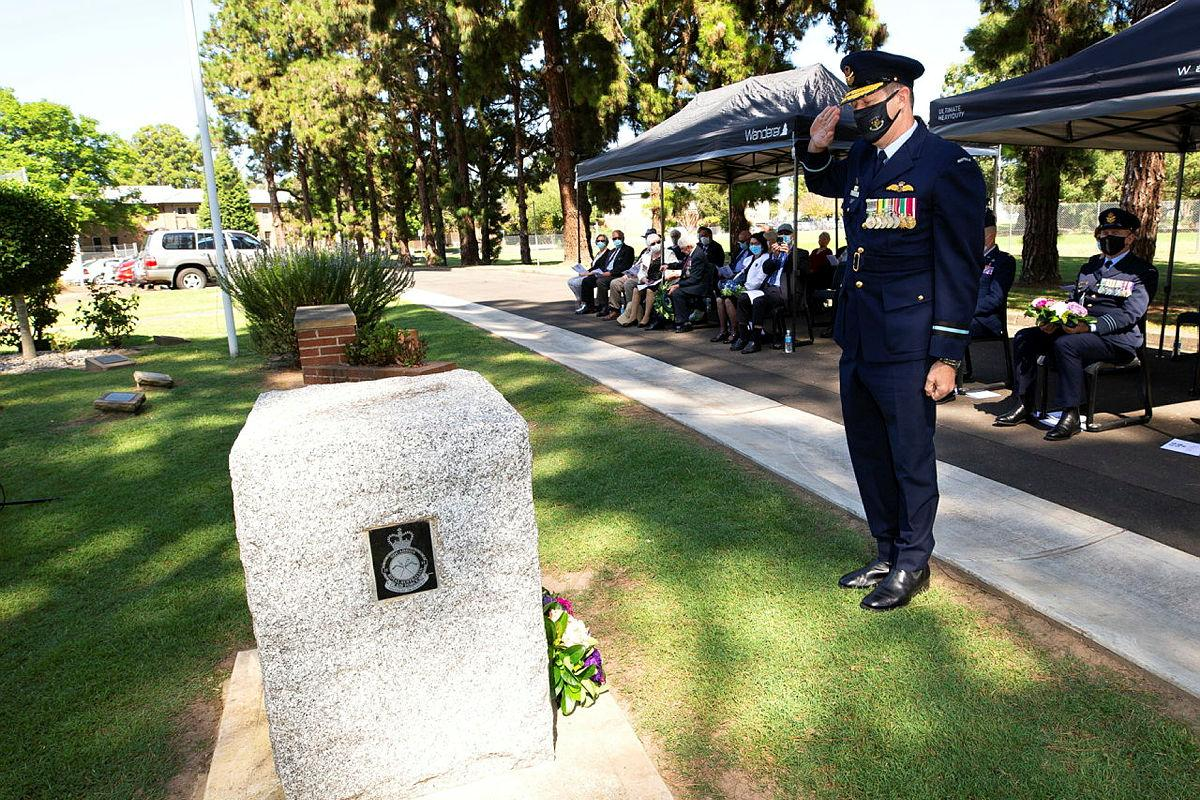 Commander Air Mobility Group Air Commodore Carl Newman salutes after laying a wreath during the Battle of the Bismarck Sea commemorative service at RAAF Base Richmond. Photo: Corporal David Said