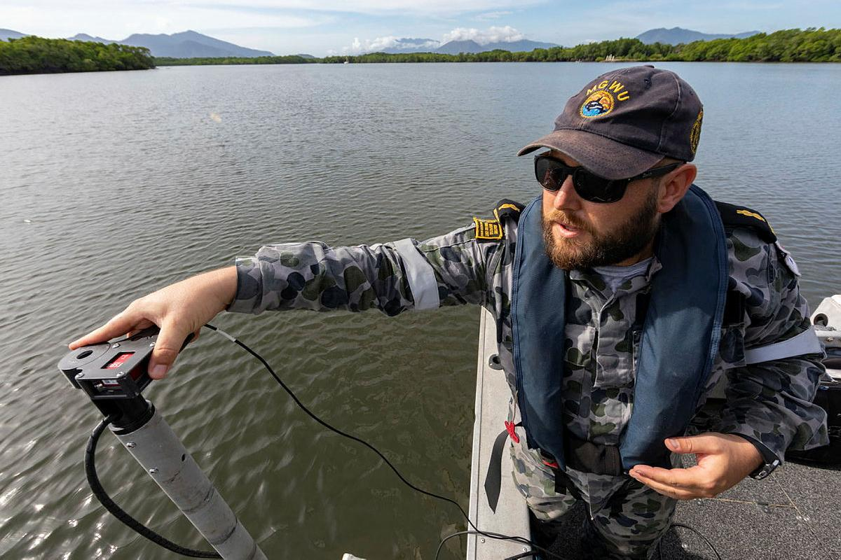 Able Seaman Hydrographic Systems Operator Andrew Hespe prepares to do a hydrographic survey in Chinaman Creek, Cairns. Photo: Leading Seaman Shane Cameron