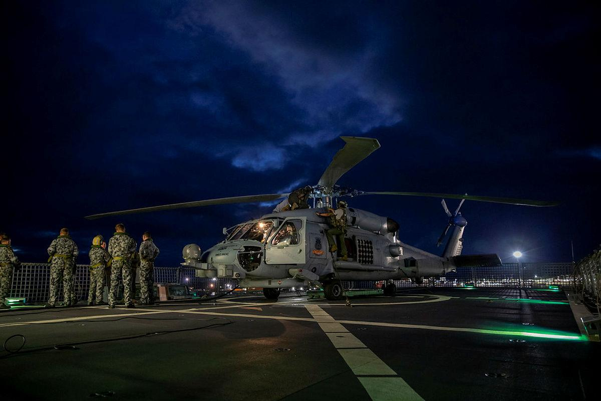 The MH-60R helicopter with the call sign Berserker being prepared for launch from HMAS Anzac. Photo: Leading Seaman Thomas Sawtell