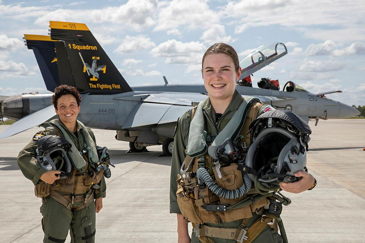 Air Force Super Hornet weapons system officer Flight Lieutenant Zalie, left, and pilot Flying Officer Sophie in front of a No. 1 Squadron F/A-18F Super Hornet at RAAF Base Amberley. Photo: Corporal Nicci Freeman