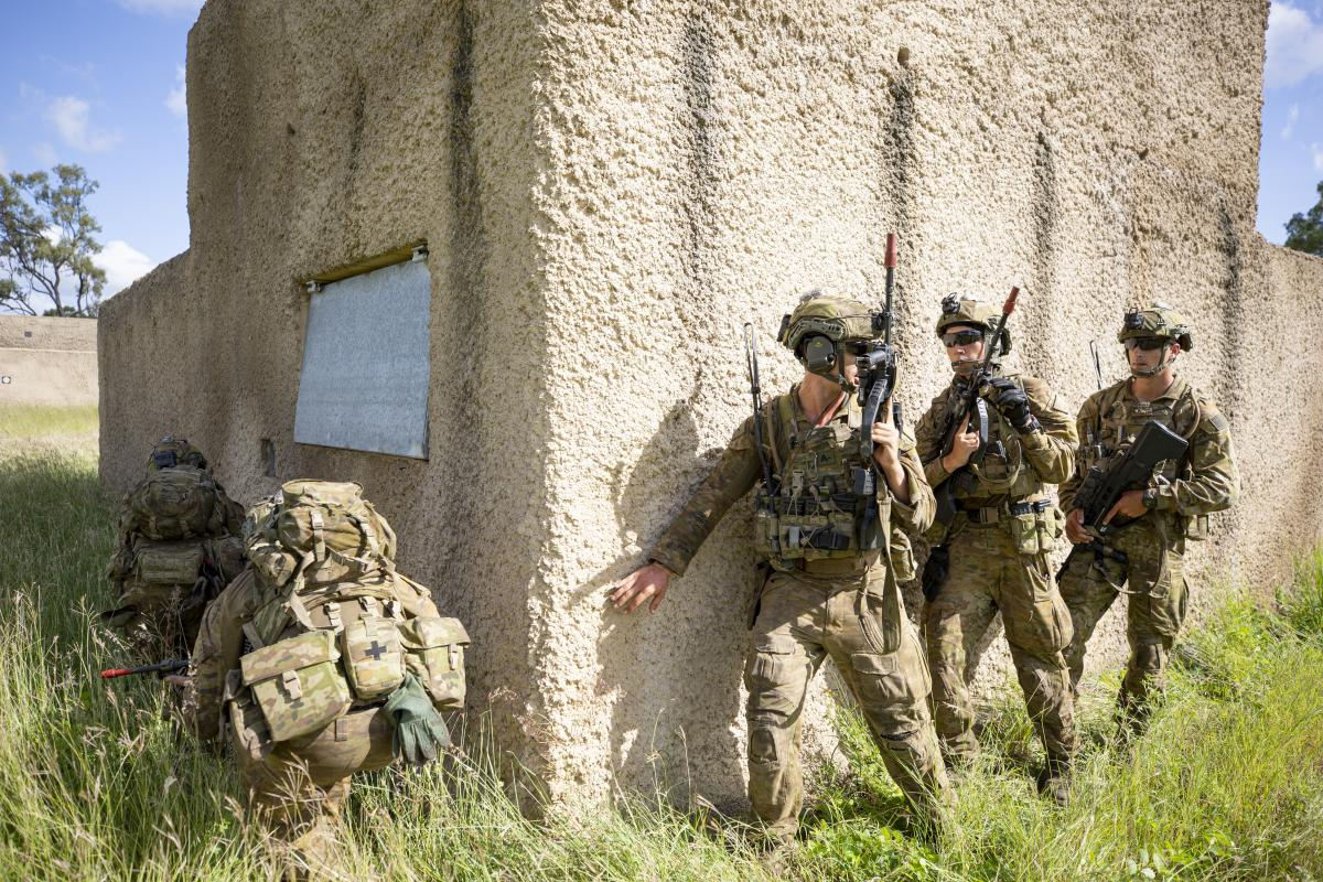 Soldiers from the 3rd Combat Engineer Regiment prepare to enter a compound during Exercise Dingo Fury at Townsville Field Training Area. Photo: Corporal Brendon Grey