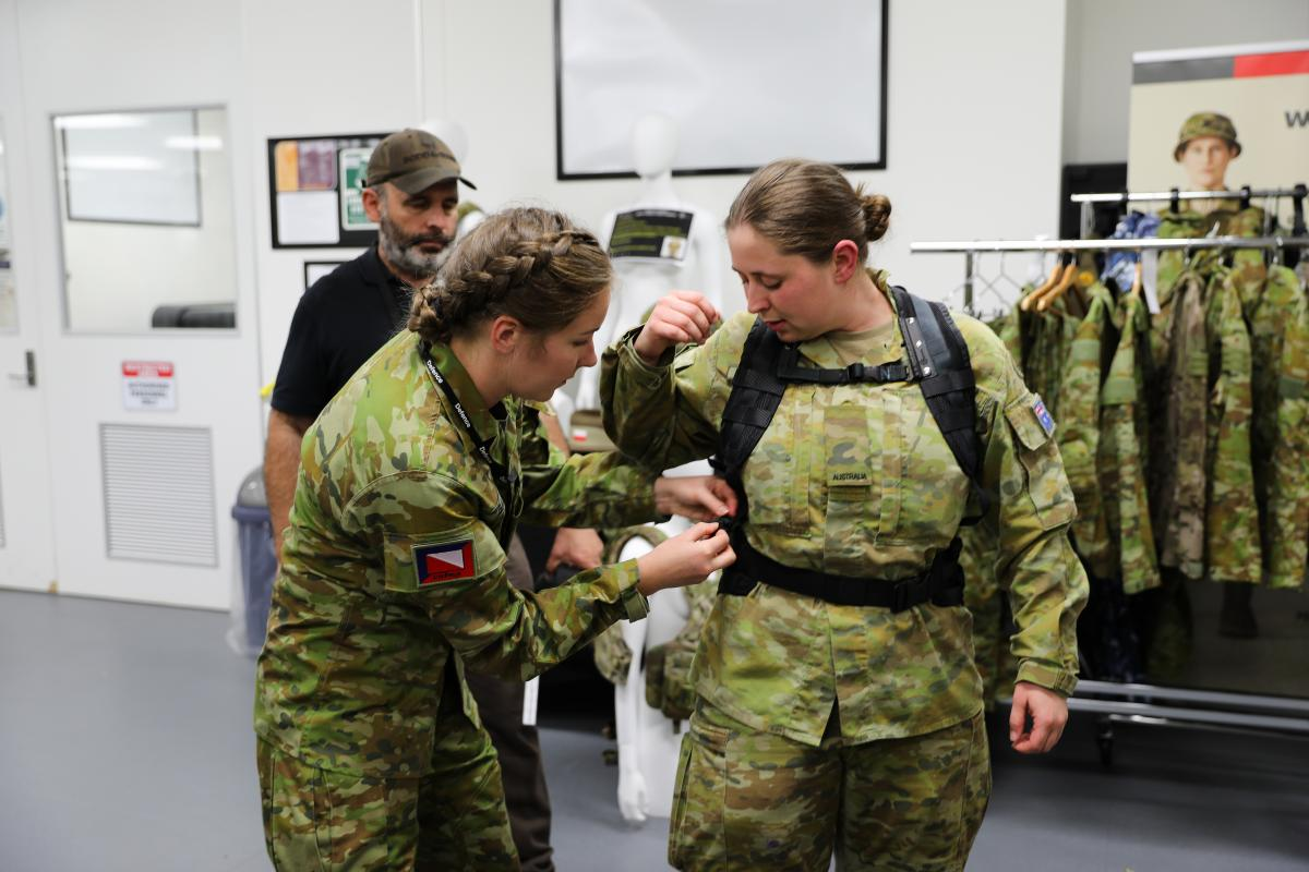Lance Corporal Rebecca Baxter from the 4th/19th Prince of Wales Light Horse Regiment adjusts the prototype female heavy-webbing harness and belt on Private Jessica Russell from the 8th/7th Battalion, Royal Victoria Regiment. Photo: Captain Kristen Cleland