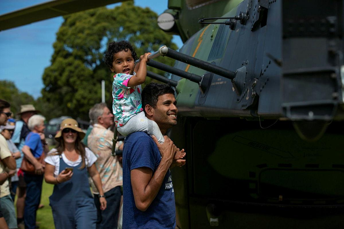 Local residents take a tour of Navy MRH-90 Taipan during HMAS Choules visit to ceremonial homeport of Mallacoota. Photo: Leading Seaman Leo Baumgartner