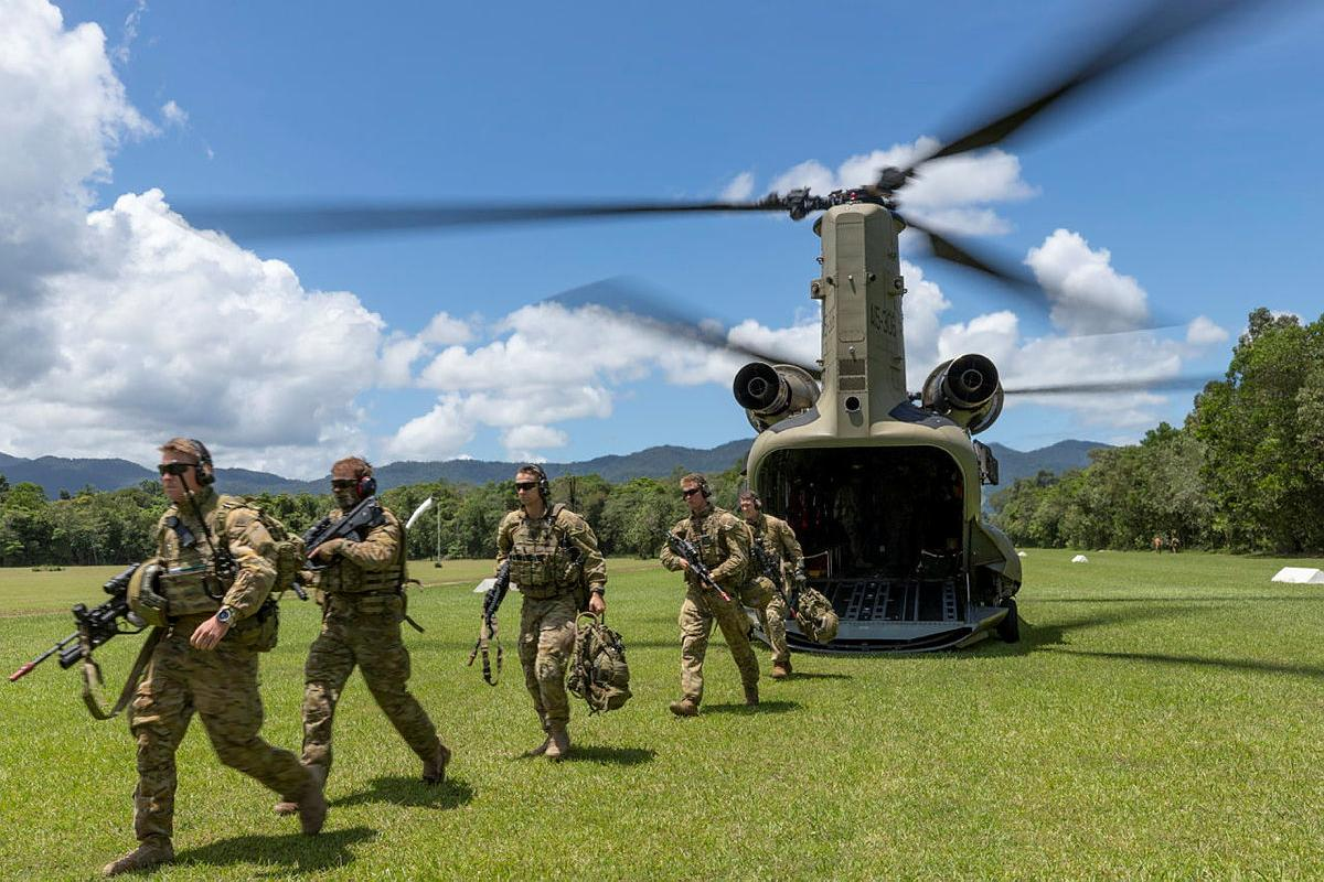 Soldiers from the 3rd Battalion exit a CH-47 Chinook during air mobile and stability operations training at the Combat Training Centre - Jungle Training Wing, Tully, Queensland. Photo: Corporal Brandon Grey