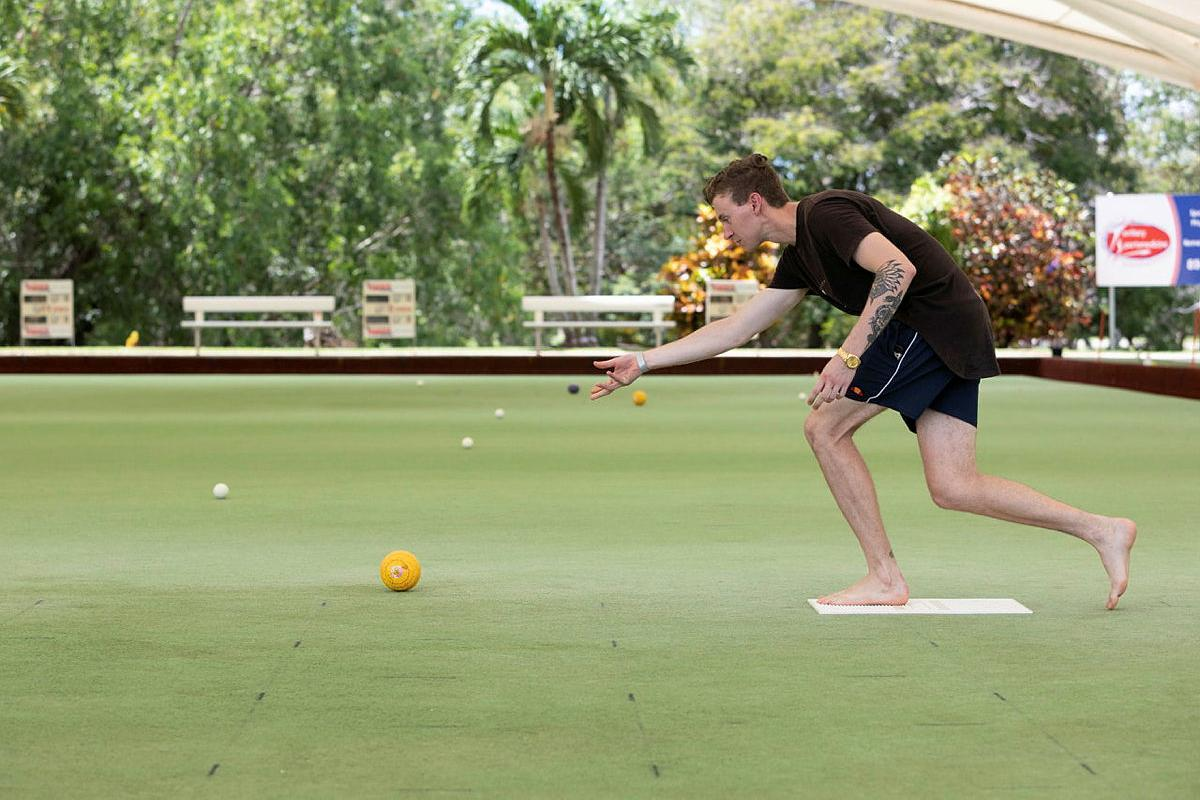 Able Seaman Lleyton Goldsmith from Fleet Logistics Support Element - Darwin bowls during the 2021 Top End Forces Shield barefoot bowls competition in Darwin. Photo: Petty Officer Peter Thompson