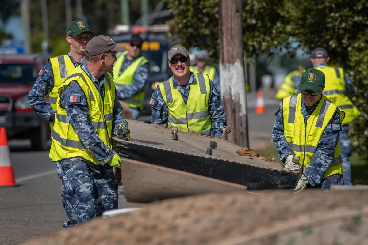 Air Force personnel remove flood-damaged items from local homes and streets in Port Macquarie during Operation NSW Flood Assist. Photo: Private Jacob Hilton