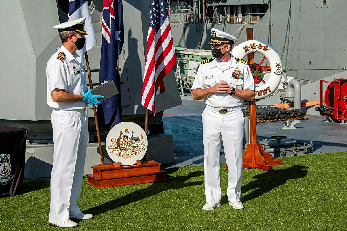 Commanding Officer HMAS Sydney Commander Ted Seymour, left, presents United States Navy officer Commander Robert Eilers with a Commander Australian Fleet Silver Commendation on board Sydney in San Diego.
