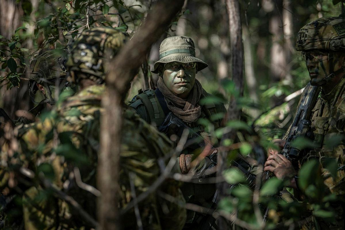 Sergeant Jone Naulivo, from the Republic of Fiji Military Forces, with soldiers from the 8th/9th Battalion, Royal Australian Regiment, during Exercise Coral Soldier. Photo: Private Jacob Hilton