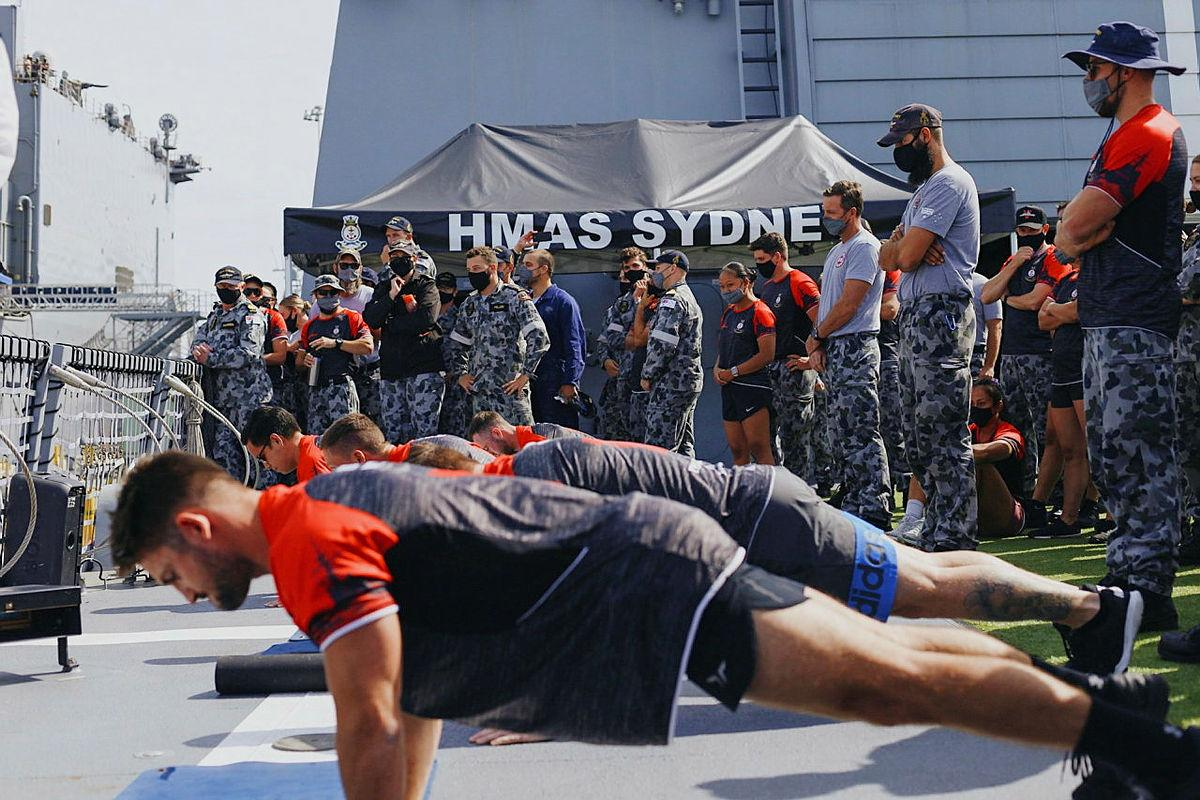 Male crew members from HMAS Sydney compete in a push-up challenge against the US Navy at Pier 4 in San Diego, US.