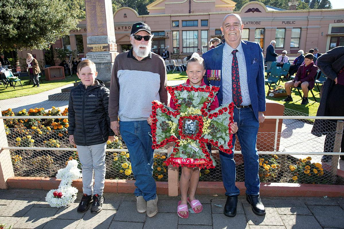 """Relatives of Ordinary Seaman Edward """"Teddy"""" Sheean, VC prepare to lay a wreath at an Anzac Day Service in Latrobe, Tasmania. From left, Mr Andrew Jarvie, Mr Ted Sheean, Miss Bella Sheean and Mr Garry Ivory. Photo: Petty Officer Tom Gibson"""