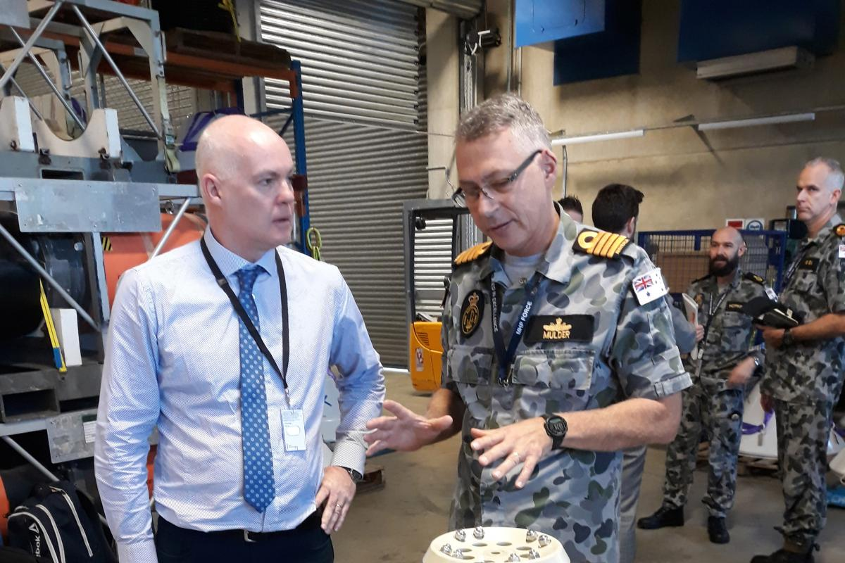 Director of Mission Systems PTY David Battle discusses with Captain Etienne Mulder from the Mine Warfare and Clearance Diving Group about the use of a generator used to jam mine firing systems.