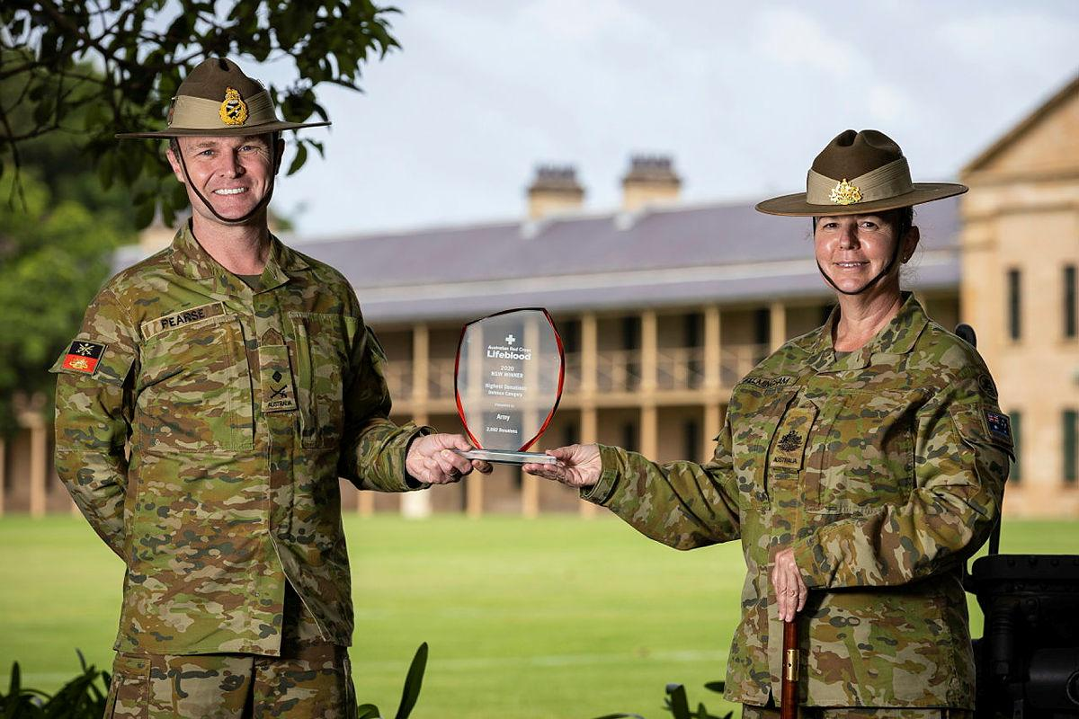 Commander Forces Command Major General Matthew Pearse and Command Sergeant Major Warrant Officer Class One Kim Felmingham hold the trophy on behalf of Army at Victoria Barracks, Sydney. Photo: Sergeant Nunu Campos