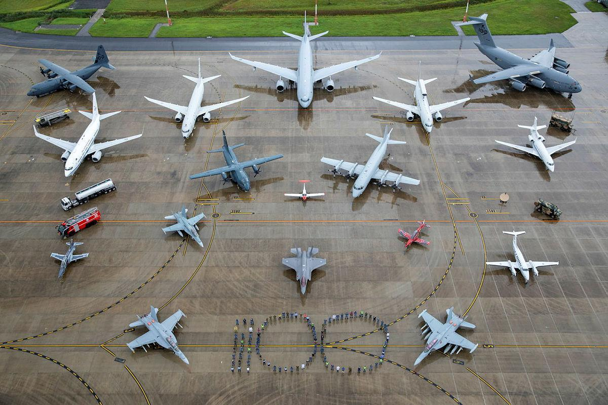 Air Force personnel representing all specialisations and musterings  form the number 100 with all in-service RAAF aircraft and ground assets at RAAF Base Amberley, Queensland. Photo: Corporal Nicci Freeman